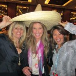 Eying the Tequila Destination Party up for auction at Taste the World were Darion Kones, left, Lisa Stout and Sharon Chan-Knight.